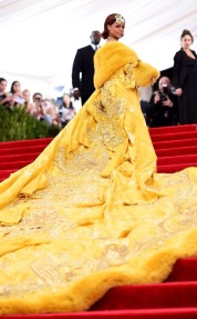 Rihanna stuns everyone in a custom Guo Pei robe with fur laced and Cartier jewels.