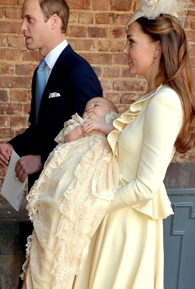 Prince George of Cambridge with his parents Duke and Duchess of Cambridge after his ceremony. The first future king to be christened in the replica of the Victorian gown.
