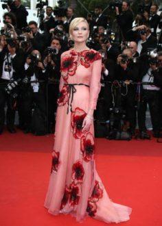 Kirsten Dunst in Gucci and Salvatore Ferragamo Clutch