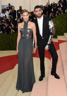 Gigi Hadid in Tommy Hilfiger and Zayn in Versace