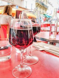 Glass of wine over lunch on Avenue de Champs Elysees, Paris