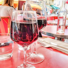 Glass of wine over lunch on Avenue de Champs Elysees, Paris